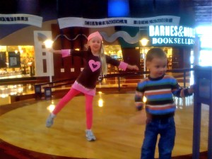 Tanner and Jake dancing on the stage at Opry Mills